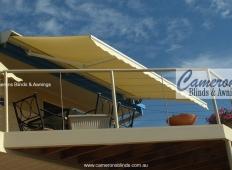 """""""Turnils Ibiza"""" Folding Arm Awning on balcony with scalloped valance   Mornington Peninsula"""