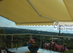 """Turnils Ibiza"" Folding Arm Awning on balcony with scalloped valance"
