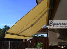 """Turnils Ibiza"" Folding Arm Awning in courtyard"