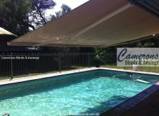 """""""Turnils Ibiza"""" Folding Arm Awning Semi Cassette over pool"""
