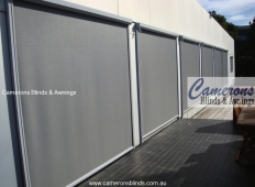 Straight Drop Sun Blinds in Mesh PVC - Side Channel Guided Vertiscreen®